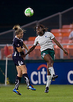 Cat Whitehill (4) of the Washington Freedom goes up for a header against India Trotter (11) of the Saint Louis Athletica at RFK Stadium in Washington, DC.  The Washington Freedom defeated Saint Louis Athletica, 3-1.