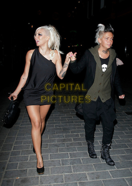 JODIE MARSH & her girlfriend Nina.Seen leaving Volstead Club on their way Chinawhite nightclub, London, England, November 11th 2008..full length black dress shoes couple  girlfriend gold shoulder buckle biker boots green cardigan one shoulder holding hands tattoos.CAP/AH.©Adam Houghton/Capital Pictures