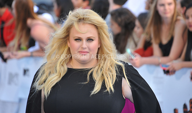 WWW.ACEPIXS.COM<br /> <br /> April 12 2015, LA<br /> <br /> Rebel Wilson arriving at the 2015 MTV Movie Awards at the Nokia Theatre L.A. Live on April 12, 2015 in Los Angeles, California.<br /> <br /> By Line: Peter West/ACE Pictures<br /> <br /> <br /> ACE Pictures, Inc.<br /> tel: 646 769 0430<br /> Email: info@acepixs.com<br /> www.acepixs.com
