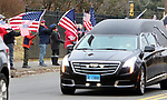 WATERBURY CT. 31 December 2018-123118SV06-Flag wavers line East Main Street as the hearse carrying Zeqir &quot;Ziggy the Flag Man&quot; Berisha enters Calvary Cemetery in Waterbury Monday.<br /> Steven Valenti Republican-American