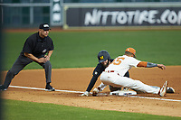 Brandt Belk (21) of the Missouri Tigers slides into third base ahead of the tag by Cam Williams (55) of the Texas Longhorns as umpire Michael Banks looks on during game eight of the 2020 Shriners Hospitals for Children College Classic at Minute Maid Park on March 1, 2020 in Houston, Texas. The Tigers defeated the Longhorns 9-8. (Brian Westerholt/Four Seam Images)