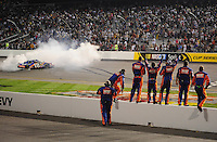 May 1, 2009; Richmond, VA, USA; NASCAR Nationwide Series driver Kyle Busch celebrates after winning the Lipton Tea 250 at the Richmond International Raceway. Mandatory Credit: Mark J. Rebilas-