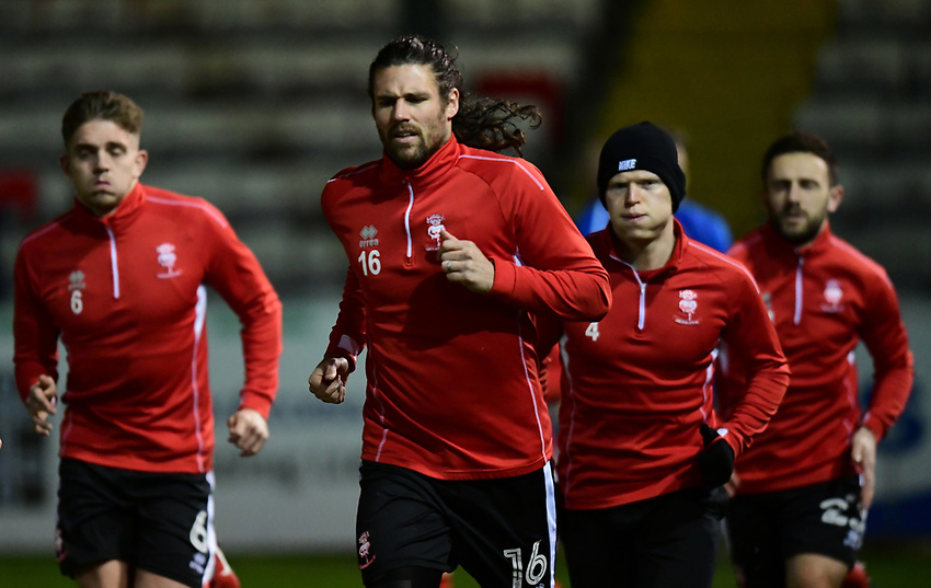 Lincoln City's Michael Bostwick during the pre-match warm-up<br /> <br /> Photographer Chris Vaughan/CameraSport<br /> <br /> The EFL Checkatrade Trophy Fourth Round - Lincoln City v Peterborough United - Tuesday 23rd January 2018 - Sincil Bank - Lincoln<br />  <br /> World Copyright &copy; 2018 CameraSport. All rights reserved. 43 Linden Ave. Countesthorpe. Leicester. England. LE8 5PG - Tel: +44 (0) 116 277 4147 - admin@camerasport.com - www.camerasport.com