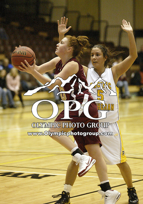 02 January 2009:  Pacific Lutheran University  guard #5 Nikki Scott tries to slow down Willamette's #10 Alex Zennan as she dries to the hoop at Olson Auditorium in Tacoma, WA.  Pacific Lutheran University won 65-52 over Willamette.