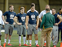 Jordan Cowart, Ben Turk, Manti Te'o and Robby Toma listen to instructions.