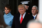 United States President Donald Trump and Melania Trump depart the 2017 Presidential Inauguration at the US Capitol in Washington, DC on January 20, 2017. US Vice President Mike Pence is at right. <br /> Credit: Jack Gruber / Pool via CNP