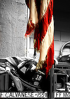 photographed at NYFD, Tenhouse, the fire station directly across the street from Ground Zero. This tattered flag was pulled from out from the ruins and now hangs over FF Moriabata's locker.