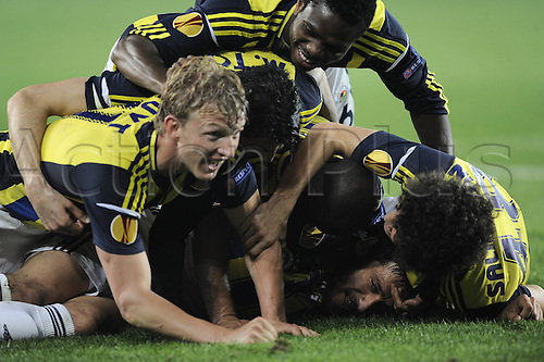 25.04.2013. Instanbul, Turkey.  UEFA Europe League Semi Final  1st leg Match between Fenerbahce and Benfica AT Sukru Saracoglu Stadium.  Egemen Korkmaz, Dirk Kuyt and other Fenerbahces Players Celebrates After Fenerbahce won the game by a score of 1-0.