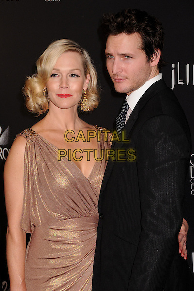 JENNIE GARTH & PETER FACINELLI.11th Annual Costume Designers Guild Awards at the Four Seasons Beverly Wilshire Hotel, Beverly Hills, California, USA..February 17th, 2009.half length married couple husband wife shiny shimmery cream gold black suit jacket stubble facial hair dress grecian style draped dangling earring beige.CAP/ADM/BP.©Byron Purvis/AdMedia/Capital Pictures.