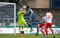 Goalkeeper Jamie Jones of Stevenage saves from Rowan Liburd of Wycombe Wanderers during the Sky Bet League 2 match between Wycombe Wanderers and Stevenage at Adams Park, High Wycombe, England on 12 March 2016. Photo by Andy Rowland/PRiME Media Images.