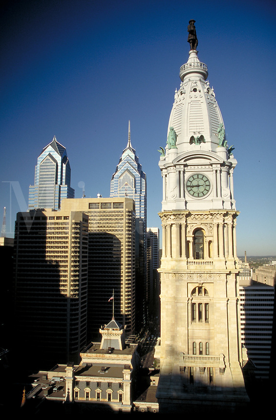 From high in an adjacent building a view of the statue of William Penn and downtown modern highrises. Philadelphia Pennsylvania United States City Center.
