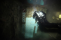 Monday, June 21, 2010:  Diver Jay Scwartz of the San Diego Oceans Foundation enters the wreck of the HMCS Yukon to inspect and clean commerative plagues placed inside before it sank off Mission Beach almost ten years ago.  The wreck which was prepared and sunk for recreational divers to enjoy will have been underwater for ten years in July of this year.