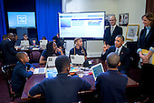 """United States President Barack Obama, right, talks to middle-school students who are participating in an """"Hour of Code"""" event in the Eisenhower Executive Office Building next to the White House in Washington, D.C., U.S., on Monday, December 8, 2014. The event is in honor of Computer Science Education Week. <br /> Credit: Andrew Harrer / Pool via CNP"""
