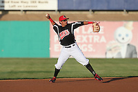 Edwin Garcia (24) of the High Desert Mavericks makes a throw during a game against the Inland Empire 66ers at Mavericks Stadium on May 6, 2015 in Adelanto, California. Inland Empire defeated High Desert, 10-4. (Larry Goren/Four Seam Images)