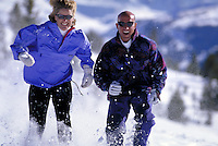 Winter, Vacation, Sports, Active Lifestyle, Adventure, Snowshoeing, Wilderness, Woman, Mountains, Man, Couple, Forest, Racing, Fitness, Training, Exercise, Running. Asa Armstrong & Bruce Ruff (MR 648, 613). Backcountry Colorado United States Rocky Mountai