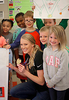 NWA Democrat-Gazette/DAVID GOTTSCHALK Former University of Arkansas pole vaulter Sandi Morris poses for a photograph Friday, March 9, 2018, with students at Butterfield Trail Elementary School in Fayetteville. Morris recently returned from the 2018 IAAF World Indoor Championships in Birmingham, England where she won the gold medal in pole vault. Morris was given a homecoming at the school that included signs, chants, autographs and high fives as the entire school body greeted her in the hallways as she walked by.