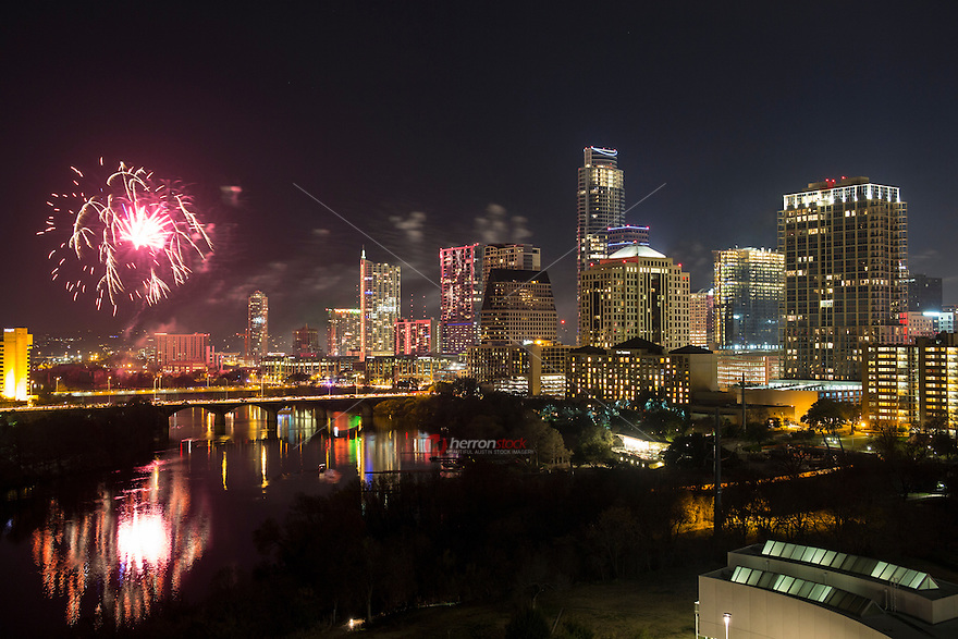 Austin celebrates Happy New Year with spectacular fireworks display over downtown skyline and Lady Bird Town Lake Austin.