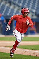 GCL Nationals second baseman Luis Garcia (7) runs to first base during the second game of a doubleheader against the GCL Mets on July 22, 2017 at The Ballpark of the Palm Beaches in Palm Beach, Florida.  GCL Mets defeated the GCL Nationals 4-1.  (Mike Janes/Four Seam Images)