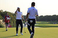 Rory McIlroy (NIR) and Xander Schauffele (USA)after the first playoff hole during the final round of the WGC HSBC Champions, Sheshan Golf Club, Shanghai, China. 03/11/2019.<br /> Picture Fran Caffrey / Golffile.ie<br /> <br /> All photo usage must carry mandatory copyright credit (© Golffile | Fran Caffrey)