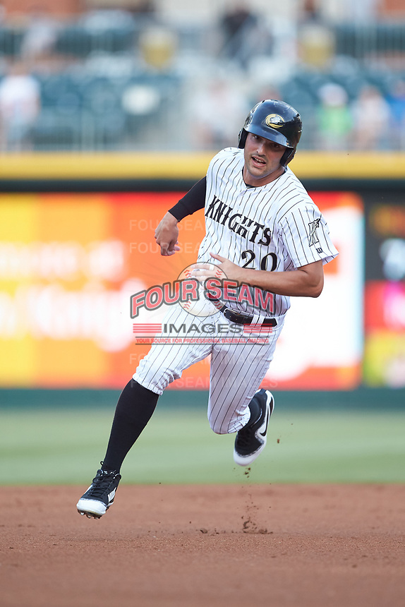 Patrick Leonard (20) of the Charlotte Knights hustles towards third base against the Indianapolis Indians at BB&T BallPark on May 26, 2018 in Charlotte, North Carolina. The Indians defeated the Knights 6-2.  (Brian Westerholt/Four Seam Images)