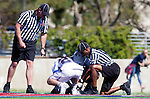Los Angeles, CA 03/12/16 - Referees, Drew Marinelli (Loyola Marymount #22) and Trevin Roberts (Utah State #16) in action during the Utah State vs Loyola Marymount MCLA Men's Division I game at Leavey Field at LMU.  Utah State defeated LMU 17-4.