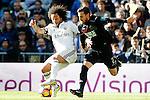 Real Madrid's Marcelo Vieira (l) and Granada CF's Tito Roman during La Liga match. January 7,2016. (ALTERPHOTOS/Acero)