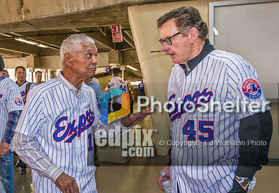 29 March 2014: Former Montreal Expos Manager Felipe Alou (left) chats with his 1994 pitching coach Joe Kerrigan (right) prior to a pre-season exhibition game between the Toronto Blue Jays and the New York Mets  at Olympic Stadium in Montreal, Quebec. Members of the 1994 Expos were honored in a pre-game ceremony where 50, 229 fans watched the Blue Jays shut out the Mets 2-0 in the first MLB professional baseball series since September of 2004. Mandatory Credit: Ed Wolfstein Photo *** RAW (NEF) Image File Available ***