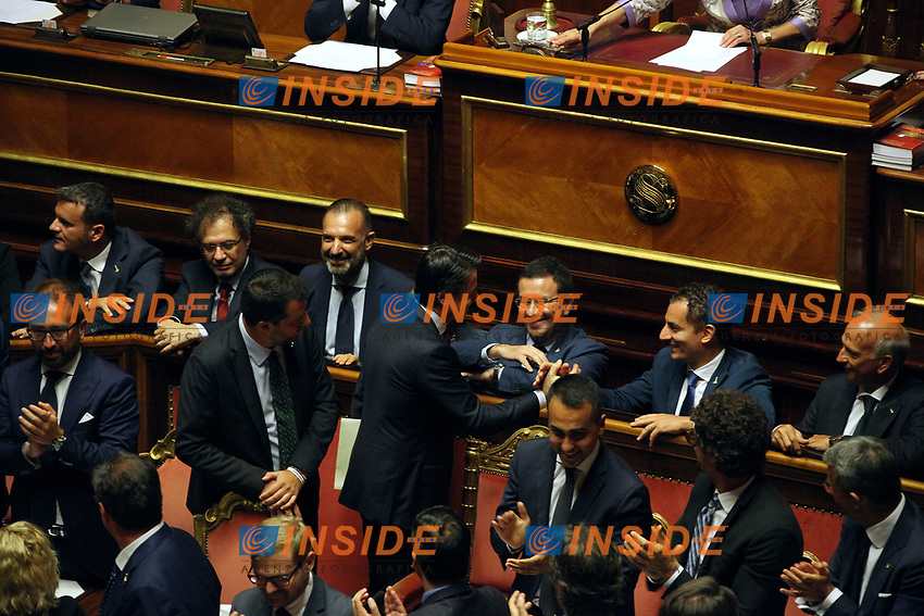 Giuseppe Conte, with Matteo Salvini and Luigi di Maio greeting ministers<br /> Rome August 20th 2019. Senate. Speech of the Prime Minister about the crisis of Government. Just after the speech the Premier went to the President of the Republic to resign<br /> Foto  Insidefoto