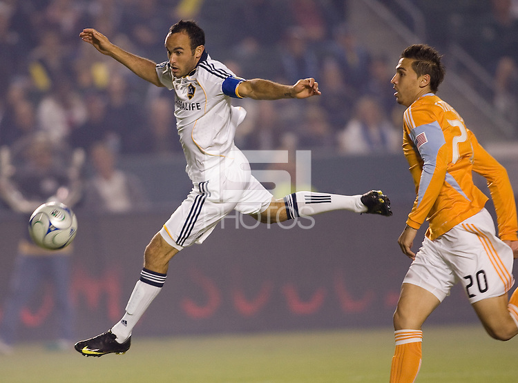 LA Galaxy midfielder Landon Donovan narrowly misses a chance at a goal early in the first half as Dynamo defender Geoff Cameron looks on. The LA Galaxy defeated the Houston Dynamo 2-0 in OT to win the MLS Western Conference Final at Home Depot Center stadium in Carson, California on Friday November 13, 2009...