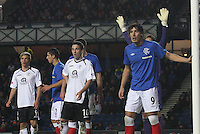 Nicky Clark (centre) as Francisco Sandaza (right) guards the post at a corner in the Rangers v Queen of the South Quarter Final match in the Ramsdens Cup played at Ibrox Stadium, Glasgow on 18.9.12.