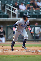 Travis Blankenhorn (6) of the Pensacola Blue Wahoos follows through on his swing against the Birmingham Barons at Regions Field on July 7, 2019 in Birmingham, Alabama. The Barons defeated the Blue Wahoos 6-5 in 10 innings. (Brian Westerholt/Four Seam Images)