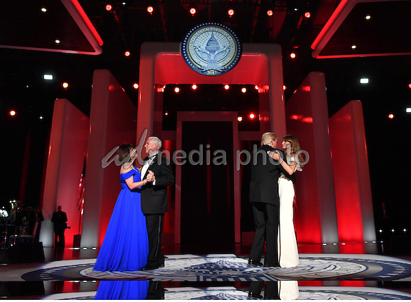 President Donald Trump and First Lady Melania Trump dance along Vice President Mike Pence and his wife Karen Pence at the Liberty Ball at the Washington Convention Center on January 20, 2017 in Washington, D.C. Trump will attend a series of balls to cap his Inauguration day. Photo Credit: Kevin Dietsch/CNP/AdMedia