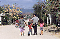 "Inmigrants from Central America in Chiapas, Southern Mexico, before boarding a train in their attempt to reach the US border. They are the poorest persons among the inmigrants, they got to Mexico walking from Honduras, Guatemala or Nicaragua. Once in Mexico they can rest in shelters run by catholic priests before facing the dangerous train travel. In this step, they are often abused by police and gangs that steal the men and rape the women..Una familia guatemalteca sale del albergue ""Hogar de la Misericordia"", en Arriaga, Chiapas."