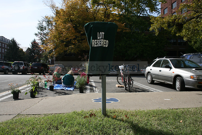 The UK Greenthumb club sits in parking spaces in the E-Lot on Funkhouser Dr. for Park(ing) Day on Wednesday afternoon. Photo by Adam Wolffbrandt | Staff
