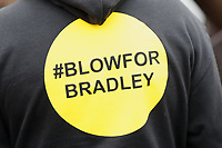 Pictured: A Blow For Bradley logo on someone's top outside St John Lloyd School, in Llanelli, Carmarthenshire, UK. Thursday 12 September 2019<br /> Re: The family of a bullied pupil were joined by friends and held a minute's silence, a year after he hanged himself in school toilets.<br /> His heartbroken father Byron John claims his son Bradley, 14, would still be alive if the school had acted to stop the bullies.<br /> Bradley's 13-year-old sister Danielle found him dead in the toilet block at, an hour after going missing at St John Lloyd Roman Catholic School in Llanelli, South Wales, UK.