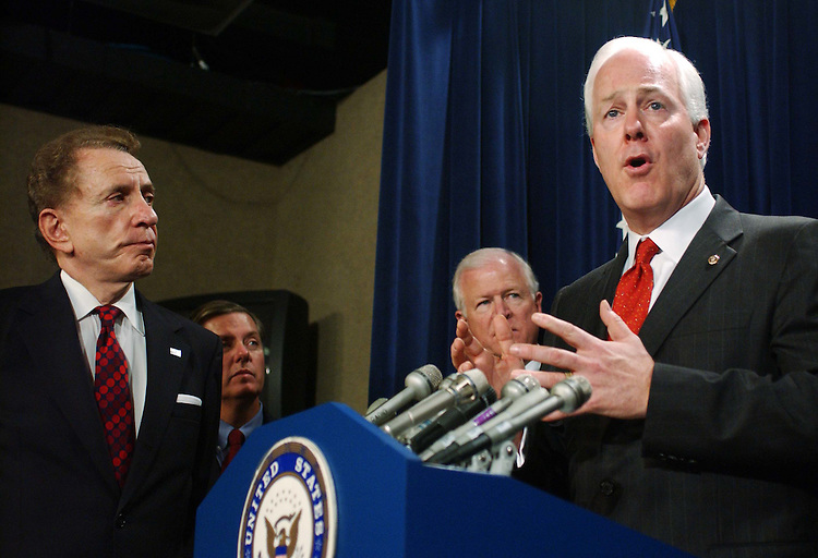 "11/18/04.SPECTER SUPPORT--Sen. Arlen Specter, R-Pa., Sen. Lindsey Graham, R-S.C., Sen. Saxby Chambliss, R-Ga., and Sen. John Cornyn, R-Texas, during a news conference in which Senate Judiciary Republicans announced their unanimous support for Specter as their next chairman..From CQ.com: ""We are definitely supporting Arlen Specter for this position,"" said Orrin G. Hatch, R-Utah, who is being forced by six-year GOP term limits to relinquish the chairmanship. ""He will be the chairman of the Senate Judiciary Committee."".Social conservatives have bombarded Senate Republicans with demands that they block Specter from becoming chairman ever since he said Nov. 3 that President Bush would have a difficult time winning confirmation of any Supreme Court nominee who was eager to overturn the landmark 1973 Roe v. Wade decision legalizing abortion nationwide..Though the actual chairmanship vote will not take place until the new Congress convenes in January, Thursday's announcement appears to assure that Specter will survive the conservative onslaught. Committee Republicans have the first vote on the chairmanship, and their recommendation must then be approved by a majority of the 55 Republicans who will serve in the 109th Congress..Flanked by his fellow committee Republicans, Specter read a statement in which he said, ""I have not and would not use a litmus test to confirm nominees."".CONGRESSIONAL QUARTERLY PHOTO BY SCOTT J. FERRELL"