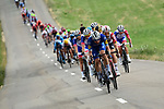 The peloton lined out during Stage 7 of the 2019 Tour de France running 230km from Belfort to Chalon-sur-Saone, France. 12th July 2019.<br /> Picture: ASO/Alex Broadway | Cyclefile<br /> All photos usage must carry mandatory copyright credit (© Cyclefile | ASO/Alex Broadway)