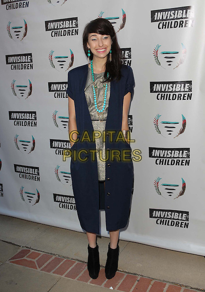 Ashley Rickards<br /> 1st Annual Founders Party For The Invisible Children's 4th Estate Leadership Summit Held At Royce Hall, UCLA, Los Angeles, California, USA, 10th August 2013.<br /> full length hands in pockets navy blue silver dress jacket green earrings necklace black ankle boots  <br /> CAP/ADM/KB<br /> &copy;Kevan Brooks/AdMedia/Capital Pictures