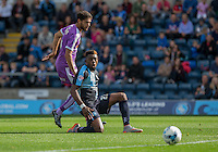 Gozie Ugwu of Wycombe Wanderers watches a shot goes close during the Sky Bet League 2 match between Wycombe Wanderers and Plymouth Argyle at Adams Park, High Wycombe, England on 12 September 2015. Photo by Andy Rowland.