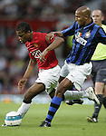 Manchester United's Patrice Evra gets past Inter Milan's Olivier Dacourt. Pic SPORTIMAGE/Dave Thompson..Pre-Season Friendly..Manchester United v Internazionale..1st August, 2007..--------------------..Sportimage +44 7980659747..admin@sportimage.co.uk..http://www.sportimage.co.uk/