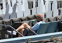25th July 2020, Los Angeles, California, USA;  Los Angeles Dodgers President and CEO Stan Kasten enjoys a drink with the cardboard cutouts during the game against the San Francisco Giants on July 25, 2020, at Dodger Stadium in Los Angeles, CA.