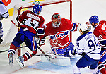 10 April 2010: Montreal Canadiens' defenseman Marc-Andre Bergeron slams into the goalpost, knocking it off its moorings during the last game of the regular season against the Toronto Maple Leafs at the Bell Centre in Montreal, Quebec, Canada. The Leafs defeated the Habs 4-3 in sudden death overtime as the Canadiens advance to the Stanley Cup Playoffs with the single point. Mandatory Credit: Ed Wolfstein Photo