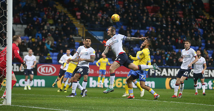 Bolton Wanderers' David Wheater denies Leeds United's Kemar Roofe a goalscoring chance<br /> <br /> Photographer Stephen White/CameraSport<br /> <br /> The EFL Sky Bet Championship - Bolton Wanderers v Leeds United - Saturday 15th December 2018 - University of Bolton Stadium - Bolton<br /> <br /> World Copyright © 2018 CameraSport. All rights reserved. 43 Linden Ave. Countesthorpe. Leicester. England. LE8 5PG - Tel: +44 (0) 116 277 4147 - admin@camerasport.com - www.camerasport.com