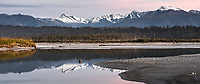 Southern Alps and Little Peak reflecting in Cook River lagoon near Fox Glacier on winter twilight, Westland Tai Poutini National Park, West Coast, UNESCO World Heritage Area, New Zealand, NZ