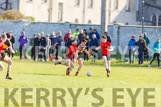 Austin Stacks Joseph O'Connor loses possession as Dara Crowley and Griffin Wharton of Kenmare puts in a challenge in Division 1 of the County Football league on Sunday