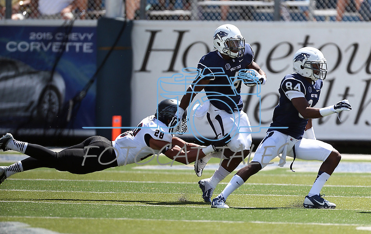 Nevada's Don Jackson (6) runs against Southern Utah defender Miles Killebrew (28) during the first half of an NCAA college football game on Saturday, Aug. 30, 2014 in Reno, Nev. Nevada's Jerico Richardson (84) is at right. (AP Photo/Cathleen Allison)