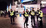 Solna 2014-10-09 Fotboll EM-kval , Sverige - Ryssland :  <br /> Poliser framf&ouml;r personer med Ukrainaflaggor och ett plakat med texten &quot;Red Card Putin&quot; utanf&ouml;r Friends Arena innan matchen mellan Sverige och Ryssland protesterar mot att Ryssland arrangerar VM 2018 <br /> (Photo: Kenta J&ouml;nsson) Keywords: Sweden Sverige Friends Arena EM Kval EM-kval UEFA Euro European 2016 Qualifier Qualifiers Qualifying Group Grupp G Ryssland Russia supporter fans publik supporters polis poliser protest protestera protsterar demonstrera demonstrerar demonstration