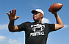 Dwight Singleton, Wyandanch athletic director and varsity football head coach, throws the pigskin to his receiving corps before a Division IV game against Center Moriches at Wyandanch High School on Thursday, Sept. 7, 2017.