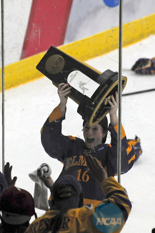 16 MAR 2013: Madison Johnston (16) of Elmira College holds up the national championship trophy  to the crowd at the Division III Women's Hockey Championship held at Wessman Arena in Superior, WI. Elmira defeated Middlebury 1-0 for the national title.  Jed Carlson/NCAA Photos