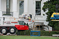 Stone masons work on the steps of the South Portico of the White House in Washington, DC as it is undergoing renovations while United States President Donald J. Trump is vacationing in Bedminster, New Jersey on Friday, August 11, 2017.<br /> Credit: Ron Sachs / CNP /MediaPunch
